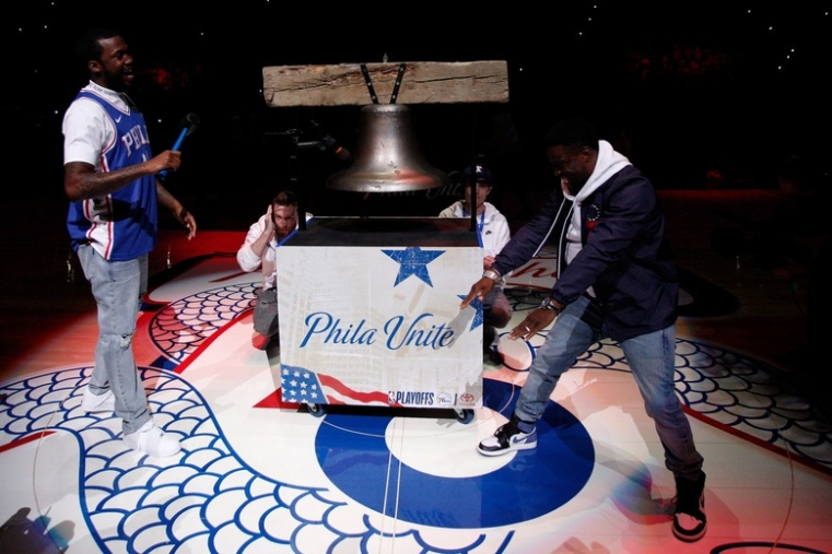 Meek Mill - a big 76ers fan - rings the